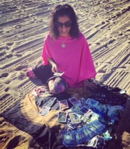 Jennifer reading tarot on the beach